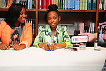 CORAL GABLES, FL - JUNE 15: (L-R) Reginae Carter daughter of rapper Lil' Wayne and Bria Williams daughter of Bryan ?Birdman? Williams greet fans and sign copies of their book Paparazzi Princesses at Books and Books on June 15, 2013 in Coral Gables, Florida. (Photo by Johnny Louis/jlnphotography.com)