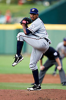 Jeremy Jeffress (30) of the Northwest Arkansas Naturals winds up during a game against the Springfield Cardinals and the Springfield Cardinals at Hammons Field on July 30, 2011 in Springfield, Missouri. Springfield defeated Northwest Arkansas 11-5. (David Welker / Four Seam Images)