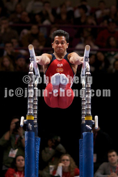 3/1/08 - Photo by John Cheng -  Raj Bhavsar of the United States performs on the parallel bars at the Tyson American Cup in Madison Square GardenPhoto by John Cheng - Tyson American Cup 2008 in Madison Square Garden, New York.Bhavsar