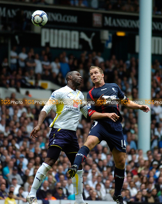 Ledley King in the air with Bolton's Kevin Davies - Tottenham Hotspur vs Bolton Wanderers - Barclays Premier League Football at White Hart Lane - 01/05/10 - MANDATORY CREDIT: Anne-Marie Sanderson/TGSPHOTO - Self billing applies where appropriate - 0845 094 6026 - contact@tgsphoto.co.uk - NO UNPAID USE..