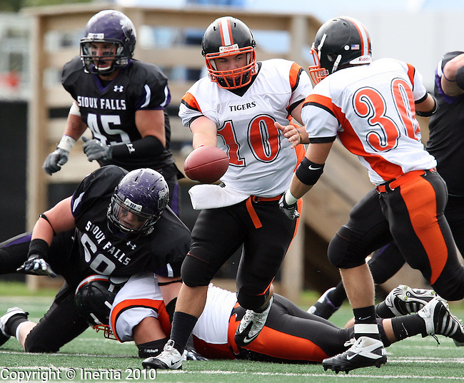 SIOUX FALLS, SD - SEPTEMBER 18: Anthony Dunn #10 of Doane College hands the football off to Alex Dose #30 against the University of Sioux Falls in the first quarter of their game Saturday afternoon at the University of Sioux Falls/Sanford Sports Complex. (photo by Dave Eggen/Inertia)