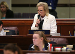 Nevada Assemblywoman Victoria Dooling, R-Henderson, works on the Assembly floor at the Legislative Building in Carson City, Nev., on Tuesday, April 21, 2015. <br /> Photo by Cathleen Allison