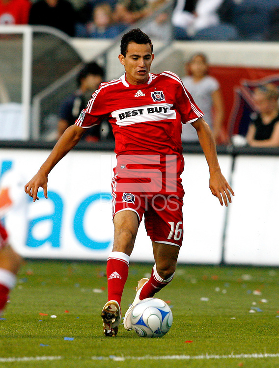 Chicago Fire midfielder Marco Pappa (16) dribbles the ball.  The Chicago Fire defeated Chivas USA 1-0 at Toyota Park in Bridgeview, IL on August 2, 2008.