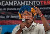 Arlino Kaiowa talks at the indigenous forum about the problems the Kaiowa people are experiencing with developments finacned by BNDES, the Brazilian Development Bank. The People's Summit at the United Nations Conference on Sustainable Development (Rio+20), Rio de Janeiro, Brazil, 18th June 2012. Photo © Sue Cunningham.