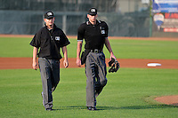Home plate umpire Aaron Higgins and base umpire Ryan Powers take the field prior to the Pioneer League game between the Idaho Falls Chukars and the Ogden Raptors on July 26, 2014 at Lindquist Field in Ogden, Utah. (Stephen Smith/Four Seam Images)