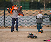 NWA Democrat-Gazette/BEN GOFF @NWABENGOFF<br /> Hunter Chandler (left), 7, and brother Rylan Chandler, 4, of Bentonville play with their controll cars Wednesday, Jan. 10, 2018, at Memorial Park in Bentonville.