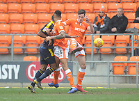 Blackpool's Ben Heneghan clears the loose ball despite the attentions of Oxford United's Jerome Sinclair<br /> <br /> Photographer Kevin Barnes/CameraSport<br /> <br /> The EFL Sky Bet League One - Blackpool v Oxford United - Saturday 23rd February 2019 - Bloomfield Road - Blackpool<br /> <br /> World Copyright © 2019 CameraSport. All rights reserved. 43 Linden Ave. Countesthorpe. Leicester. England. LE8 5PG - Tel: +44 (0) 116 277 4147 - admin@camerasport.com - www.camerasport.com