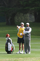 Tiger Woods gets some advise from his long time caddy Steve Williams during the World Golf Championships at Harding Park in San Francisco Oct. 2005. .(photo/Ron Riesterer)