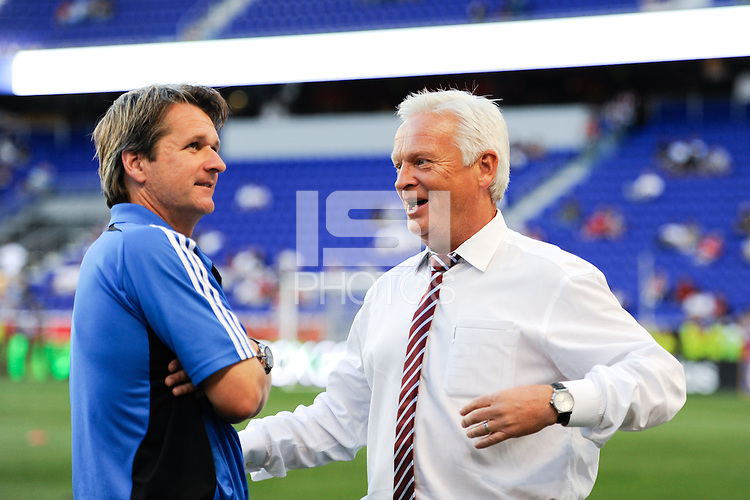New York Red Bulls head coach Hans Backe (R) and San Jose Earthquakes head coach Frank Yallop (L) talk before the game. The New York Red Bulls defeated the San Jose Earthquakes 2-0 during a Major League Soccer (MLS) match at Red Bull Arena in Harrison, NJ, on August 28, 2010.