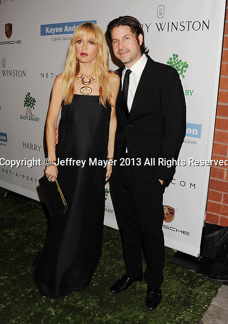 CULVER CITY, CA- NOVEMBER 09: Fashion designer Rachel Zoe (L) and husband Roger Berman arrive at the 2nd Annual Baby2Baby Gala at The Book Bindery on November 9, 2013 in Culver City, California.