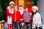 Clodagh and Cathal McCarthy with Mrs Clause, Santa and elf at the An Riocht Snowed In winter wonderland, Castleisland on Friday