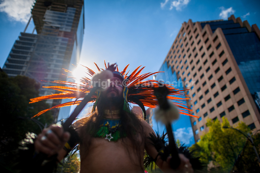 A Mexican man, wearing a colorful feather headgear inspired by Aztecs, plays drum during the Day of the Dead celebrations in Mexico City, Mexico, 29 October 2016. Day of the Dead (Día de Muertos), a syncretic religious holiday combining the death veneration rituals of the ancient Aztec culture with the Catholic practice, is celebrated throughout all Mexico. Based on the belief that the souls of the departed may come back to this world on that day, people gather at the gravesites in cemeteries praying, drinking and playing music, to joyfully remember friends or family members who have died and to support their souls on the spiritual journey.