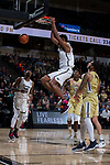 Doral Moore (4) of the Wake Forest Demon Deacons completes a slam dunk during first half action against the Georgia Tech Yellow Jackets at the LJVM Coliseum on February 14, 2018 in Winston-Salem, North Carolina.  The Demon Deacons defeated the Yellow Jackets 79-62.  (Brian Westerholt/Sports On Film)
