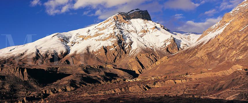 © David Paterson.Muktinath Himal and the village of Chhinga, Mustang, west-central Nepal...Keywords: Nepal, Himalaya, Mustang, Chhinga, remote, Asia, eastern, faraway, mountain, peak, summit, exotic, adventure, trek, village, snow-cap