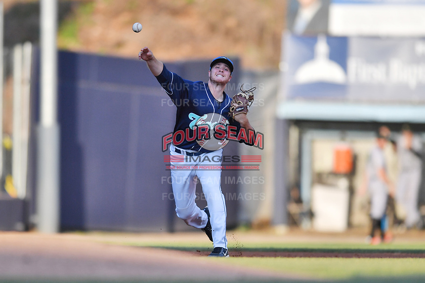 Asheville Tourists third baseman Kyle Datres (3) throws to first base during a game against the Augusta GreenJackets at McCormick Field on April 6, 2019 in Asheville, North Carolina. The Tourists defeated the GreenJackets 6-3. (Tony Farlow/Four Seam Images)