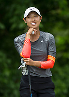 Dylan Kim smiles Tuesday, June 23, 2020, while talking to other members of her group on hole 4 during the pro-am round of the Cooper Northwest Arkansas Charity Classic golf tournament at Bella Vista Country Club. Go to nwaonline.com/200624Daily/ to see more photos.<br /> (NWA Democrat-Gazette/Ben Goff)
