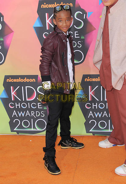 JADEN SMITH .at the 23rd Annual Nickelodeon Kids' Choice Awards 2010 held at Pauley Pavilion in Westwood, California, USA,.March 27th 2010                                                                                       arrivals kids full length sunglasses red burgandy leather brown jacket black trousers nike trainers white shirt gloves bow tie maroon .CAP/RKE/DVS.©DVS/RockinExposures/Capital Pictures
