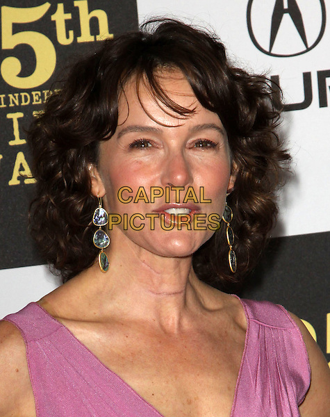 JENNIFER GREY .25th Annual Film Independent Spirit Awards held At The Nokia LA Live, Los Angeles, California, USA,.March 5th, 2010 ..arrivals Indie Spirit  portrait headshot pink dangly earrings mouth open funny .CAP/ADM/KB.©Kevan Brooks/Admedia/Capital Pictures