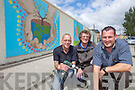 MURAL MURAL ON THE WALL: Robert Sheehy, Patrick Locke and Andrew Smith who were preparing the seven community murals at Dean's Lane, Moyderwell ready for unveiling on Friday afternoon.