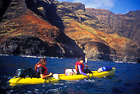 Kayaking along the Na Pali coastline, north shore wilderness