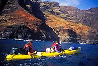 Kayaking along the Na Pali coastline, north shore wilderness