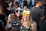 """© Joel Goodman - 07973 332324 . 04/07/2015 . Manchester , UK . JANE MURPHY (31) and JO GARRY (35) (both from Altrincham) . Fans at the Castlefield Bowl as part of the """" Summer in the City """" festival in Manchester. Photo credit : Joel Goodman"""