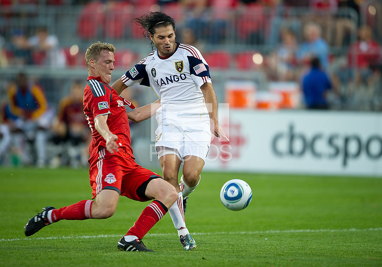 28 August 2010: Real Salt Lake forward Fabian Espindola #7 and Toronto FC defender Ty Harden #20 in action during a game between Real Salt Lake and Toronto FC at BMO Field in Toronto..The game ended in a 0-0 draw..