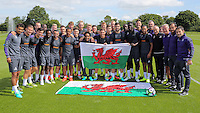 Pictured: Swansea players and staff at their training ground in Fairwood, with welsh flags showing their support to tonight's semifinal between Portugal and Wales. Wednesday 06 July 2016<br />
