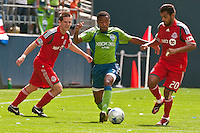 James Riley (C) of the Seattle Sounders drives between Sam Cronin (L) and Amado Guevara (20) of Toronto FC in the match at the XBox Pitch at Quest Field on August 29, 2009. The Sounders and Toronto played to a 0-0 draw.