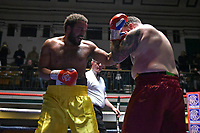 Taran Willett (yellow shorts) defeats Colin 'Butch' Goldhawk during a Boxing Show at York Hall on 30th November 2018