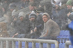 Oldham fans sheltering from the blizzard. Oldham v Portsmouth League 1