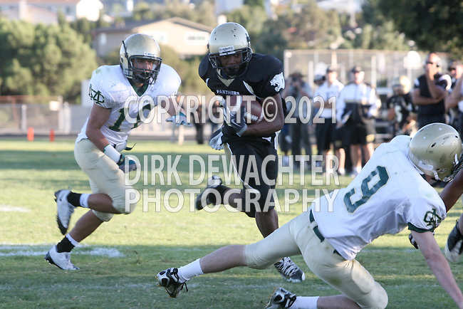 Palos Verdes, CA 10/30/09 - Okuoma Idah (#24) gets outside and gains some yards during the Peninsula-Mira Costa football game.