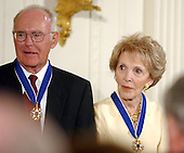 Intel co-founder Gordon Moore and former First Lady Nancy Reagan after they received the Presidential Medal of Freedom during a ceremony in the East Room of the White House in Washington, DC on 9 July, 2002.<br /> Credit: Ron Sachs / CNP