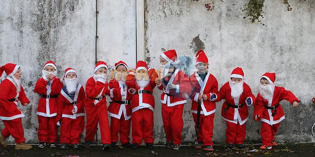 2012 Christmas Bonanza Santa Run...Photo NEWSFILE/Jenny Matthews..(Photo credit should read Jenny Matthews/NEWSFILE)