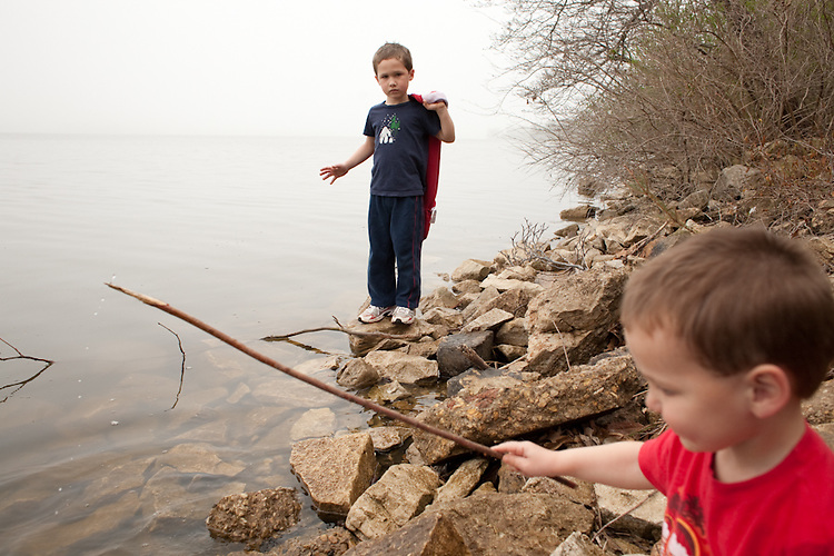 My sons, ages five and two, explore Lake Springfield near Lincoln Memorial Garden.