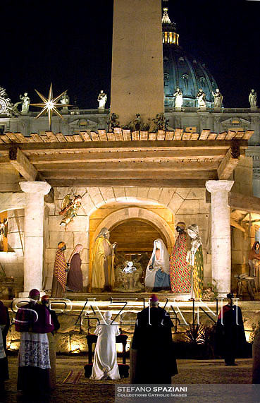 Pope Benedict XVI arrives to pray in front of the nativity in Saint Peter's Square after celebrating the Vespers and Te Deum prayers in Saint Peter's Basilica at the Vatican on December 31, 2008