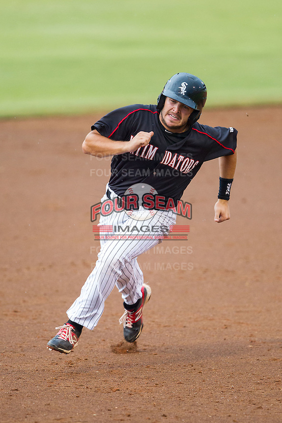 Christian Stringer (8) of the Kannapolis Intimidators hustles towards third base against the Delmarva Shorebirds at CMC-NorthEast Stadium on July 3, 2014 in Kannapolis, North Carolina.  The Shorebirds defeated the Intimidators 6-5. (Brian Westerholt/Four Seam Images)