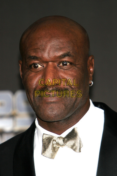 DELROY LINDO. 25 Strong: The BET Silver 25th Anniversary Special - Press Room held at the Shrine Auditorium, Los Angeles, California..October 26th, 2005.Photo: Zach Lipp/AdMedia/Capital Pictures.Ref: ZL/ADM/CAP.headshot portrait bow tie mustache facial hair.www.capitalpictures.com.sales@capitalpictures.com.© Capital Pictures.
