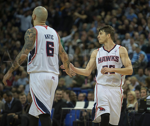 16.01.2014 London, England.  Atlanta Hawks' Guard Kyle Korver [26] celebrates with Hawks' Pero Antic [6] as he maintains his 3 point scoring record during the NBA regular season game between the Atlanta Hawks and the Brooklyn Nets from the O2 Arena.
