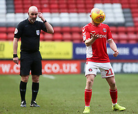 Referee Kevin Johnson cuts a confused figure as Charlton Athletic's Jonny Williams hides his face<br /> <br /> Photographer David Shipman/CameraSport<br /> <br /> The EFL Sky Bet League One - Charlton Athletic v Blackpool - Saturday 16th February 2019 - The Valley - London<br /> <br /> World Copyright © 2019 CameraSport. All rights reserved. 43 Linden Ave. Countesthorpe. Leicester. England. LE8 5PG - Tel: +44 (0) 116 277 4147 - admin@camerasport.com - www.camerasport.com