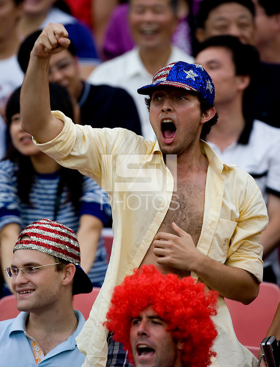 An American fan cheers on his team while they play at Worker's Stadium.  The USMNT was defeated by Nigeria, 2-1, during the 2008 Beijing Olympics in Beijing, China.