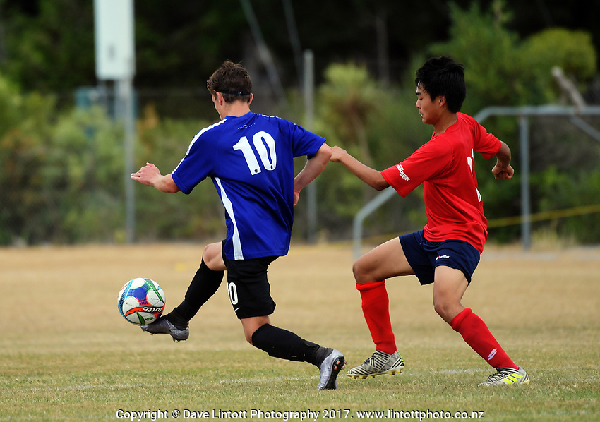 Action from the New Zealand Age Group Championships Under-16 Girls match between Auckland (white tops) and Southern at Memorial Park in Petone, Wellington, New Zealand on Wednesday, 13 December 2017. Photo: Dave Lintott / lintottphoto.co.nz