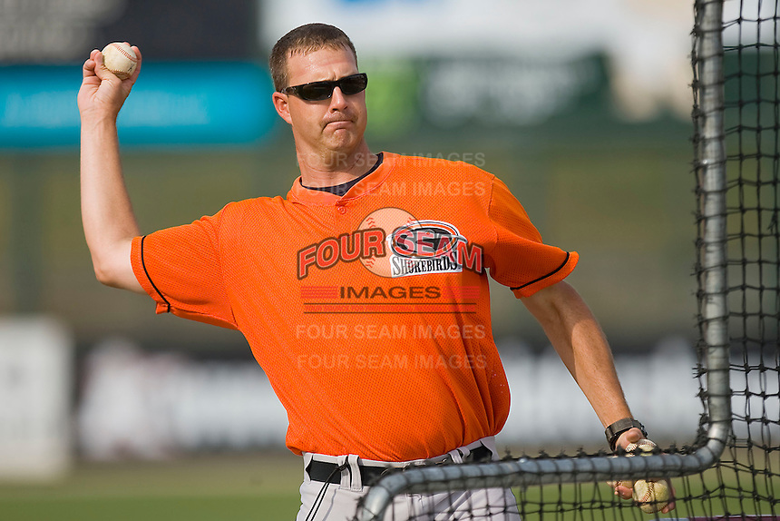 Delmarva Shorebirds pitching coach Troy Mattes #20 throws batting practice at Fieldcrest Cannon Stadium May 12, 2010, in Kannapolis, North Carolina.  Photo by Brian Westerholt / Four Seam Images