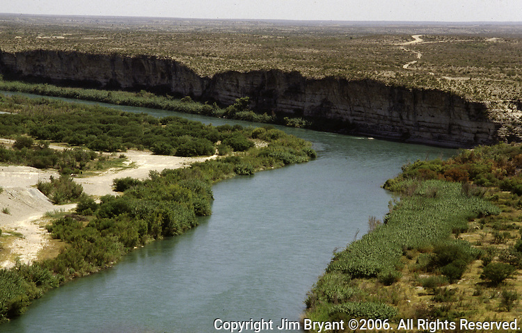 View of Mexico from the United States side of the Rio Grande River in Del Rio, Texas. While the traditional mission of the United States Border Patrol has always been the detection and prevention of the illegal entry of aliens and smuggling of illegal contraband into the United States anywhere other than a designated port-of-entry, the dawn of the age of terrorism within our nation has added a new and high priority mission: to detect and prevent the entry of terrorists and their weapons into the United States. Jim Bryant Photo..©2006. All Rights Reserved.