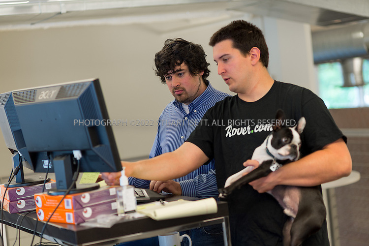 5/20/2013--Seattle, WA, USA..New employee and software engineer Johann Heller, 23 (left, blue shirt) at Rover.com, a Seattle startup that matches dog owners and dog sitters online. The company assigns mentors to new hires on their first day at work to help them start contributing from day one. Here Heller is mentored by Philip Kimmey, 23, (right, black t-short), the director of software development at Rover.com...Photograph by Stuart Isett for The Wall Street Journal