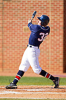 A.J. Ryan #32 of the Dayton Flyers follows through on his swing against the High Point Panthers at Willard Stadium on February 26, 2012 in High Point, North Carolina.    (Brian Westerholt / Four Seam Images)