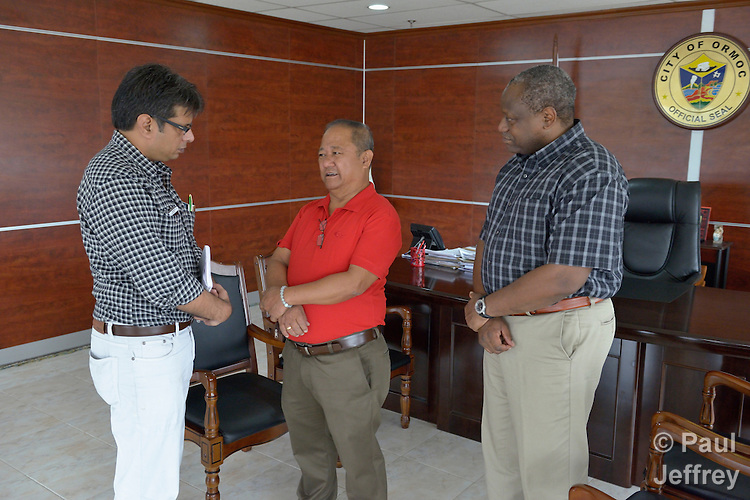 Sudhanshu Singh (left), regional coordinator for the ACT Alliance, talks with Edward Codilla (center), the mayor of Ormoc, a city in the Philippines province of Leyte that was hit hard by Typhoon Haiyan in November 2013. The storm was known locally as Yolanda. ACT Alliance members have been providing a variety of forms of assistance to survivors here, and Mayor Codilla wrote the Geneva-based network to express his appreciation. Singh accompanied ACT Alliance General Secretary John Nduna (right) during a visit to Ormoc and other typhoon-affected communities to learn first hand about the network's emergency response and long-term plans for recovery and rehabilitation.