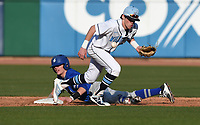 NWA Democrat-Gazette/J.T. WAMPLER  Springdale Har-Ber's Mac McCroskey can't keep a hold of the ball while  Rogers' Brandon Husted slides to second base Monday March 12, 2018 at Arvest Ballpark in Springdale. Rogers beat the Wildcats 1-0.