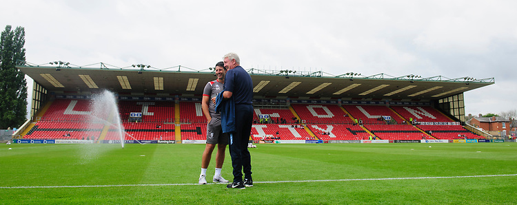 Lincoln City manager Danny Cowley, left, and Sheffield Wednesday's manager Steve Bruce prior to the game<br /> <br /> Photographer Chris Vaughan/CameraSport<br /> <br /> Football Pre-Season Friendly - Lincoln City v Sheffield Wednesday - Saturday July 13th 2019 - Sincil Bank - Lincoln<br /> <br /> World Copyright © 2019 CameraSport. All rights reserved. 43 Linden Ave. Countesthorpe. Leicester. England. LE8 5PG - Tel: +44 (0) 116 277 4147 - admin@camerasport.com - www.camerasport.com