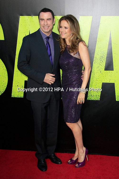 """LOS ANGELES - JUN 25:  John Travolta, Kelly Preston arrives at the """"Savages"""" Premiere at Village Theater on June 25, 2012 in Westwood, CA"""